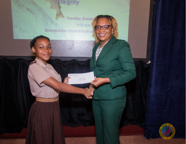 Speak-off winner Reanna John receives her prize from Novaline Brewster